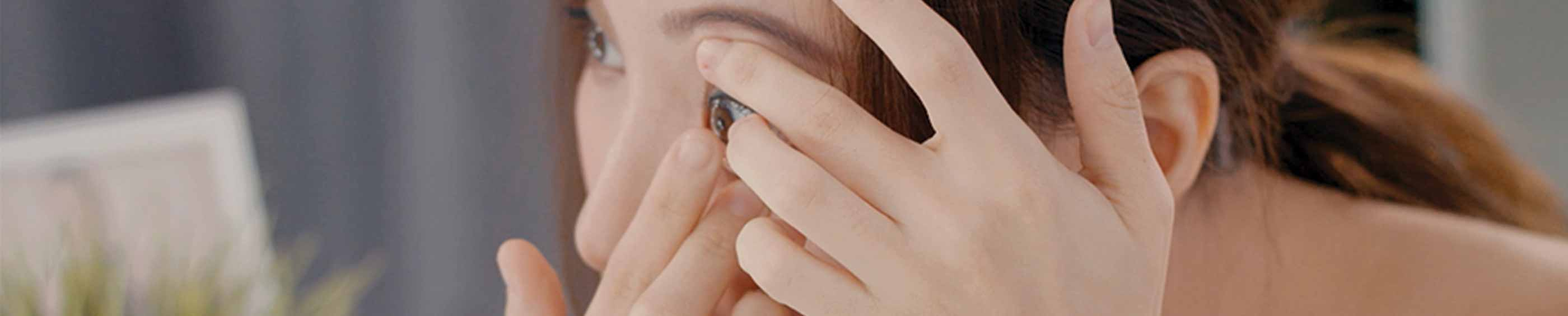 Young woman putting on ACUVUE contact lenses, Malaysia